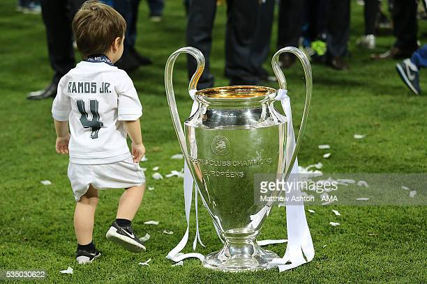 Sergio Ramos of Real Madrid's son Sergio Ramos Rubio looks at the trophy after the UEFA Champions League final match between Real Madrid and Club...