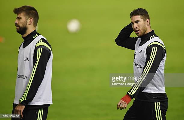 Sergio Ramos of Spain and Gerard Pique of Spain looks on during a training session ahead of their International Friendly with Germany at Estadio...