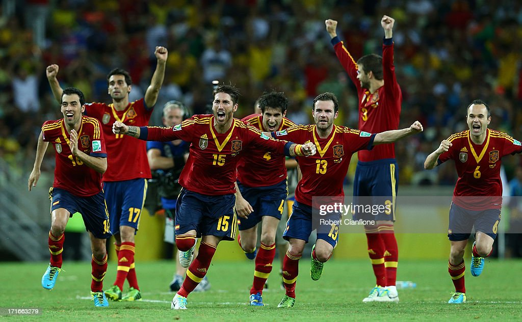 Sergio Ramos of Spain and his team-mates celebrate after Jesus Navas scored the winning penalty in a shootout during the FIFA Confederations Cup Brazil 2013 Semi Final match between Spain and Italy at Castelao on June 27, 2013 in Fortaleza, Brazil.