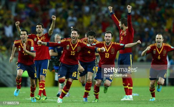 Sergio Ramos of Spain and his teammates celebrate after Jesus Navas scored the winning penalty in a shootout during the FIFA Confederations Cup...