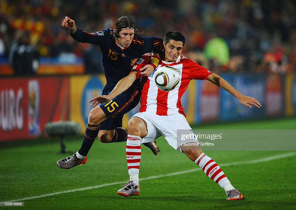 Sergio Ramos of Spain and Oscar Cardozo of Paraguay battle for the ball during the 2010 FIFA World Cup South Africa Quarter Final match between Paraguay and Spain at Ellis Park Stadium on July 3, 2010 in Johannesburg, South Africa.