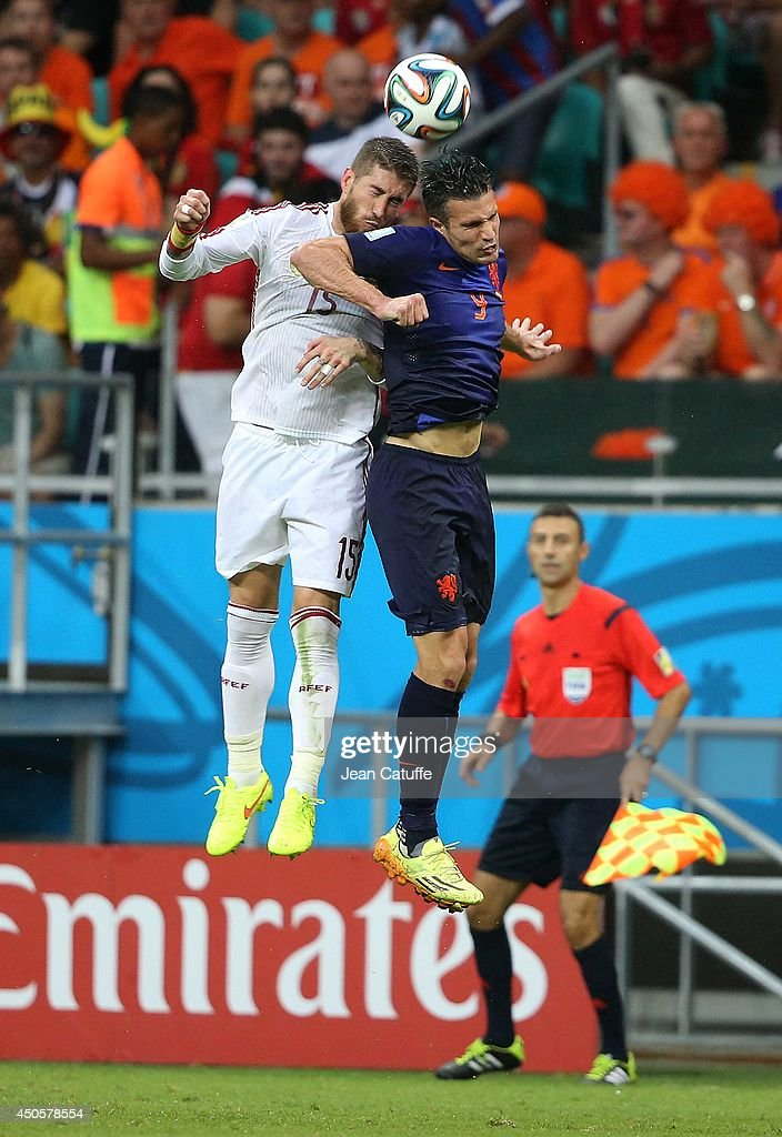 Sergio Ramos of Spain and Robin Van Persie of the Netherlands in action during the 2014 FIFA World Cup Brazil Group B match between Spain and Netherlands at Arena Fonte Nova on June 13, 2014 in Salvador, Brazil.