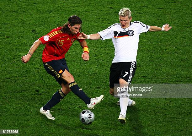 Sergio Ramos of Spain battles for the ball with Bastian Schweinsteiger of Germany during the UEFA EURO 2008 Final match between Germany and Spain at...