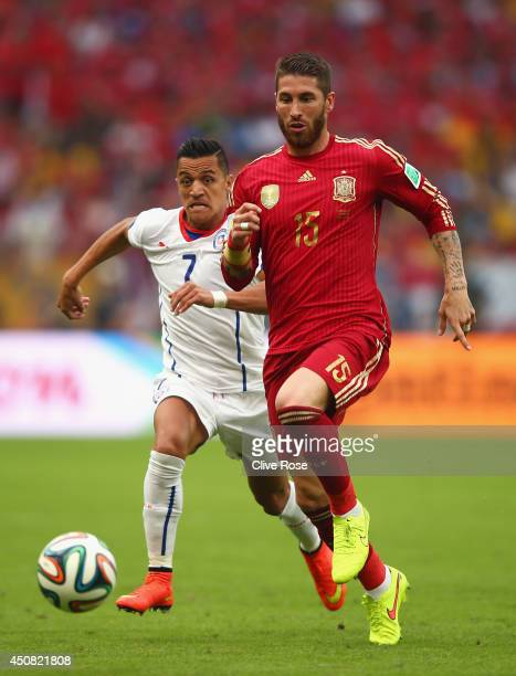 Sergio Ramos of Spain controls the ball against Alexis Sanchez of Chile during the 2014 FIFA World Cup Brazil Group B match between Spain and Chile...