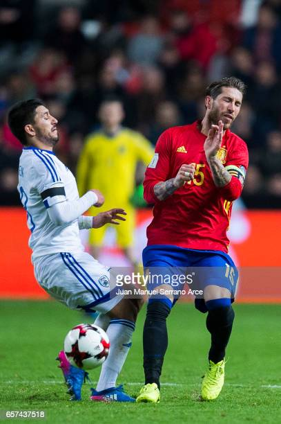 Sergio Ramos of Spain duels for the ball with Almog Cohen of Israel during the FIFA 2018 World Cup Qualifier between Spain and Israel at Estadio El...
