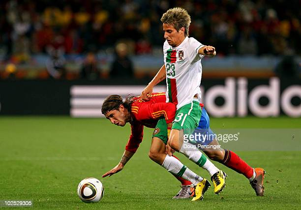 Sergio Ramos of Spain falls under the challenge of Fabio Coentrao of Portugal during the 2010 FIFA World Cup South Africa Round of Sixteen match...