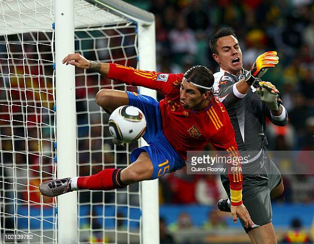 Sergio Ramos of Spain goes for a challenge with goalkeeper Diego Benaglio of Switzerland during the 2010 FIFA World Cup South Africa Group H match...