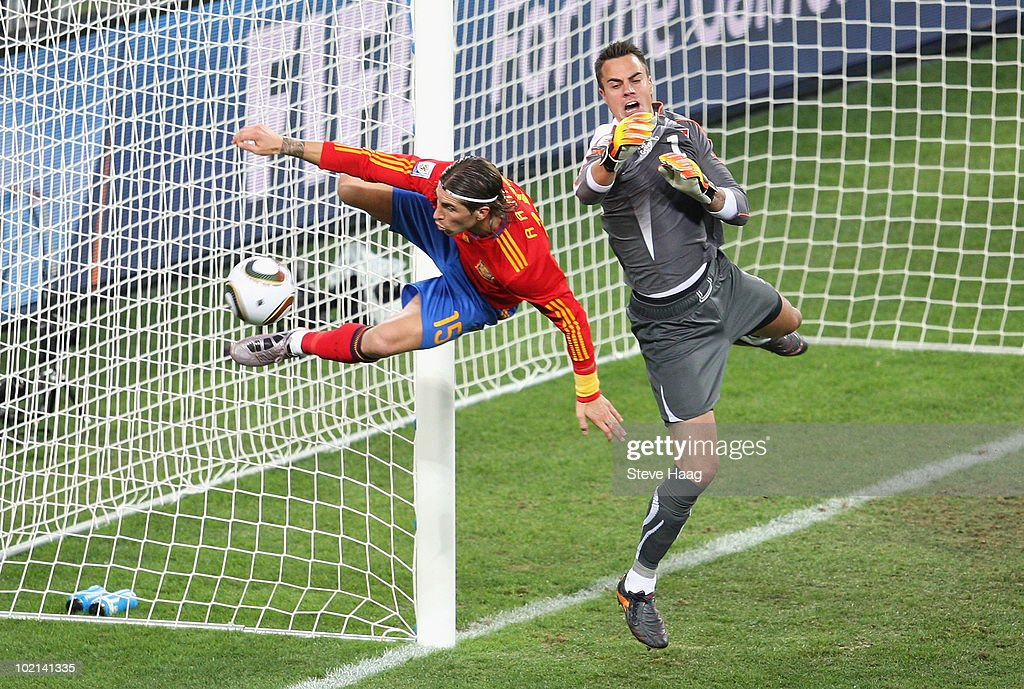 Sergio Ramos of Spain goes for a challenge with goalkeeper <a gi-track='captionPersonalityLinkClicked' href=/galleries/search?phrase=Diego+Benaglio&family=editorial&specificpeople=543817 ng-click='$event.stopPropagation()'>Diego Benaglio</a> of Switzerland during the 2010 FIFA World Cup South Africa Group H match between Spain and Switzerland at Durban Stadium on June 16, 2010 in Durban, South Africa.