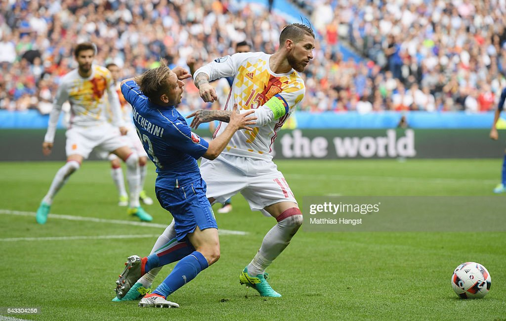 Sergio Ramos of Spain holds off <a gi-track='captionPersonalityLinkClicked' href=/galleries/search?phrase=Emanuele+Giaccherini&family=editorial&specificpeople=6675873 ng-click='$event.stopPropagation()'>Emanuele Giaccherini</a> of Italy during the UEFA EURO 2016 round of 16 match between Italy and Spain at Stade de France on June 27, 2016 in Paris, France.
