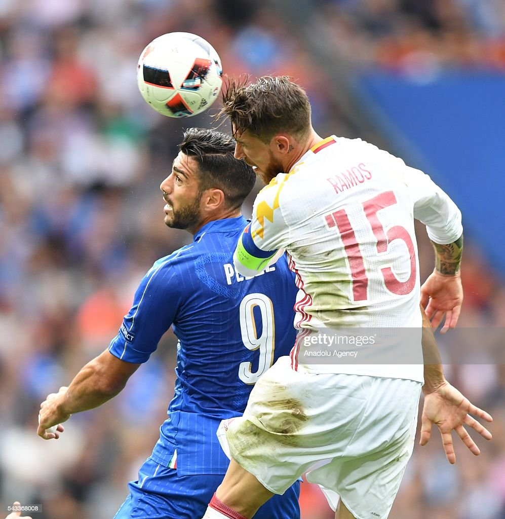 Sergio Ramos (R) of Spain in action against Graziano Pelle (L) of Italy during the UEFA Euro 2016 round of 16 football match between Italy and Spain at Stade de France in Paris, France on June 27, 2016.