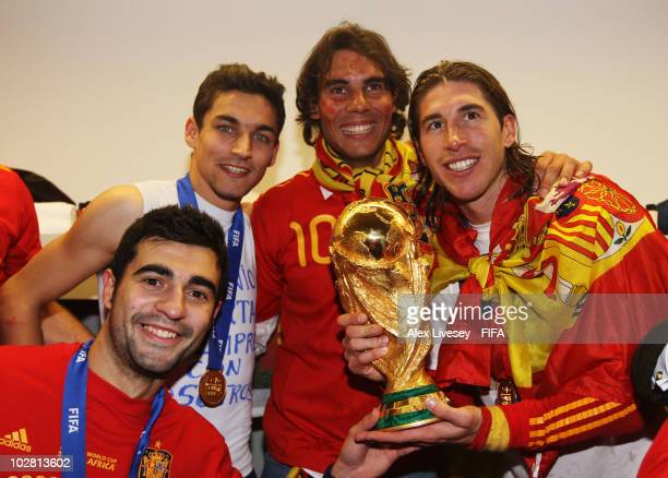Sergio Ramos of Spain Jesus Navas of Spain Raul Albiol of Spain and tennis player Rafael Nadal pose in the Spanish dressing room after they won the...