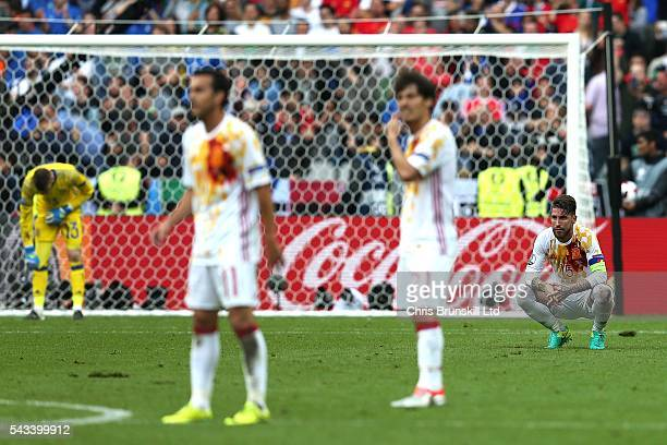 Sergio Ramos of Spain looks dejected following Italy's second goal during the UEFA Euro 2016 Round of 16 match between Italy and Spain at Stade de...
