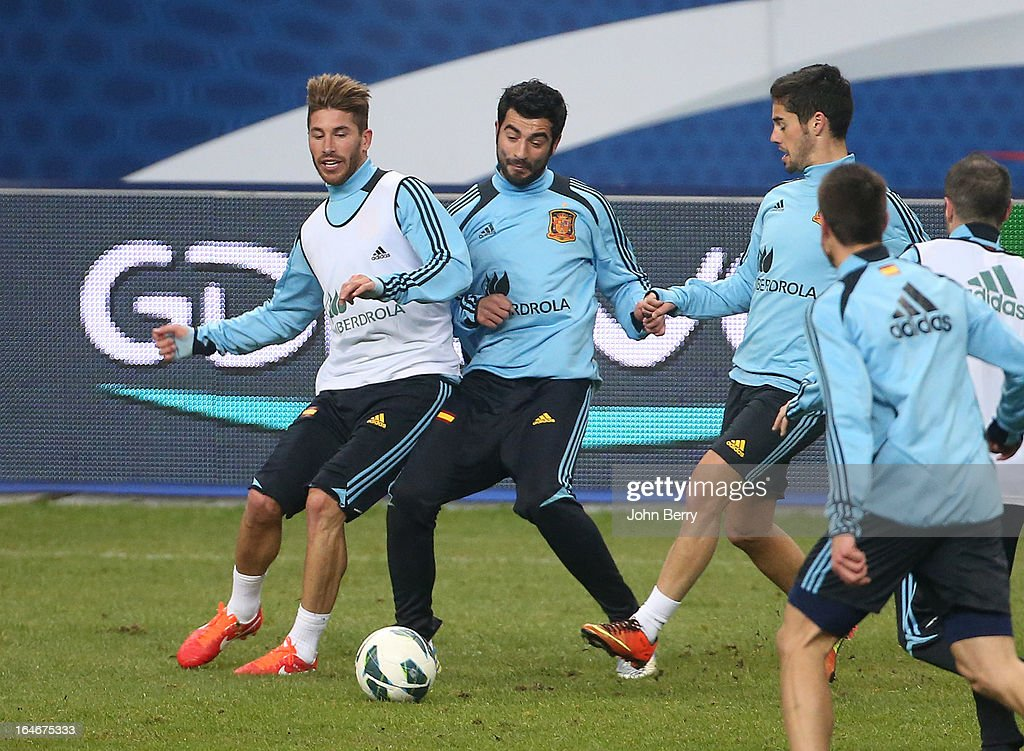 Sergio Ramos of Spain (L) warms up during the practice session the day before the FIFA World Cup 2014 qualifier between France and Spain at the Stade de France on March 25, 2013 in Saint-Denis near Paris, France.