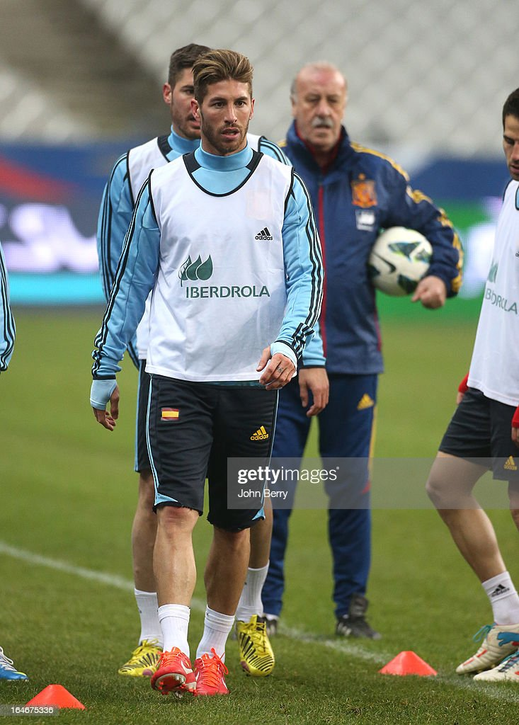 Sergio Ramos of Spain warms up while Vicente Del Bosque, coach of Spain looks on during the practice session the day before the FIFA World Cup 2014 qualifier between France and Spain at the Stade de France on March 25, 2013 in Saint-Denis near Paris, France.