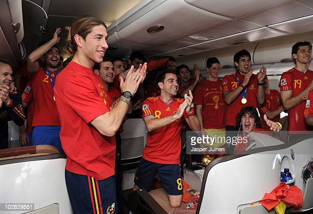 Sergio Ramos Xavi Hernandez Fernando Torres Javier Martinez Carles Puyol and Fernando Llorente celebrate during the Spanish team's flight home on...