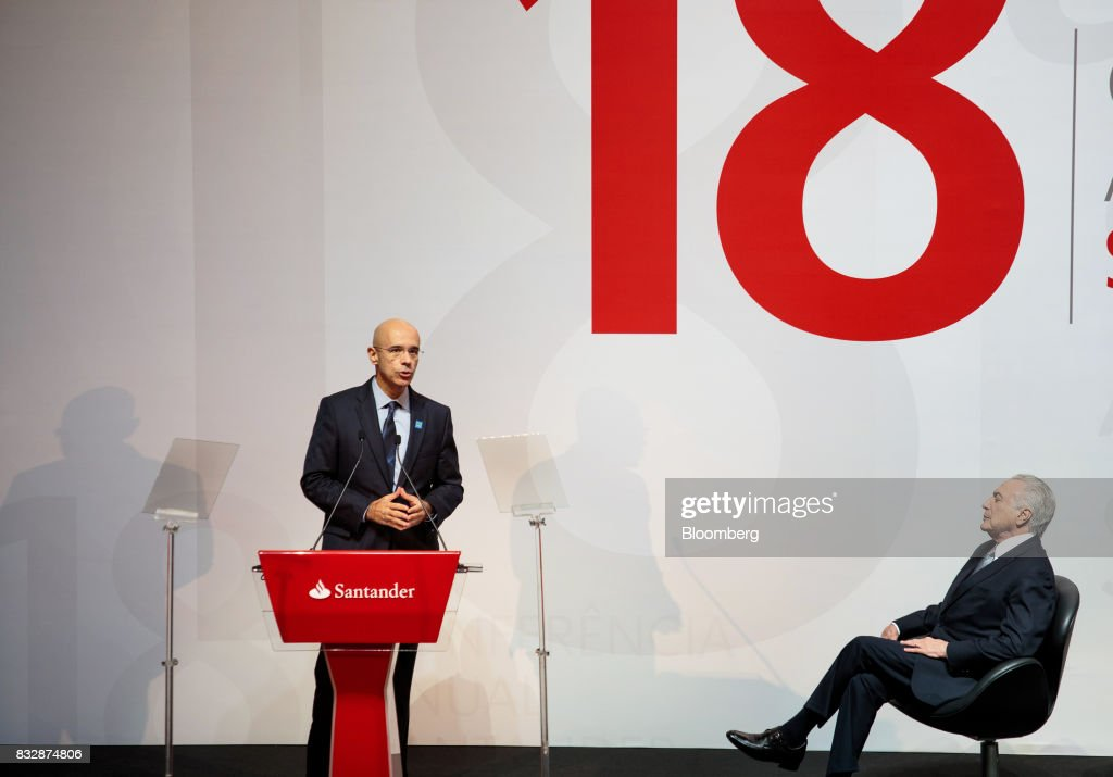 Sergio Rial, chief executive officer for Banco Santander Brasil SA, left, speaks while Michel Temer, Brazil's president, listens during the Annual Santander Conference in Sao Paulo, Brazil, on Wednesday, Aug. 16, 2017. Temer announced that he will travel to China at the end of the month to meet with the business community as interest in investing in Brazil grows. Photographer: Patricia Monteiro/Bloomberg via Getty Images