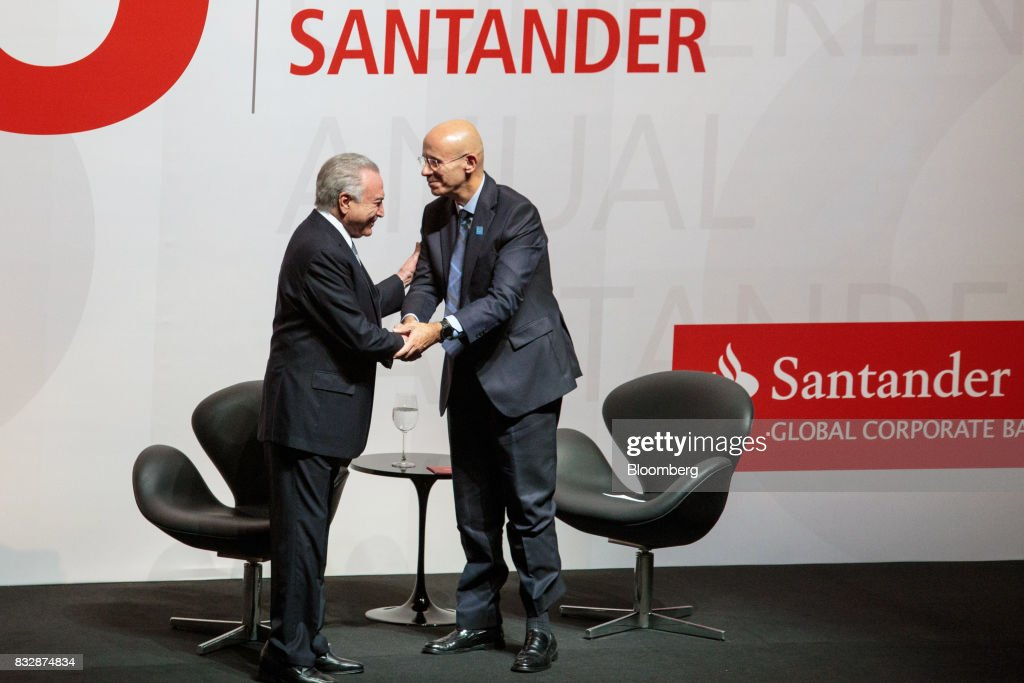 Sergio Rial, chief executive officer for Banco Santander Brasil SA, right, shakes hands with Michel Temer, Brazil's president, during the Annual Santander Conference in Sao Paulo, Brazil, on Wednesday, Aug. 16, 2017. Temer announced that he will travel to China at the end of the month to meet with the business community as interest in investing in Brazil grows. Photographer: Patricia Monteiro/Bloomberg via Getty Images