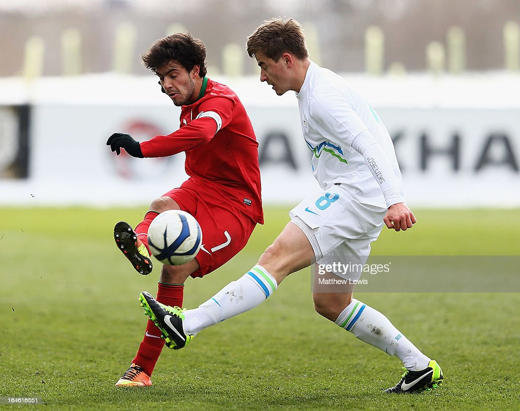 Sergio Riberio of Portugal and Nik Lorbek of Slovenia challenge for the ball during the UEFA European Under-17 Championship Elite Round match between Slovenia and Portugal at St George's Park on March 25, 2013 in Burton-upon-Trent, England.