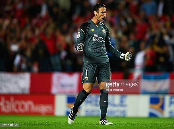 Sergio Rico of Sevilla FC celebrates after his team mate Victor Machin Perez 'Vitolo' scores the first goal during the match between Sevilla FC vs FC...