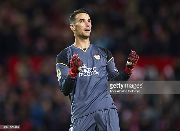 Sergio Rico of Sevilla FC celebrates after scoring his team mate Wissam Ben Yedder of Sevilla FC during the La Liga match between Sevilla FC and...