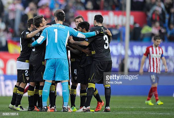 Sergio Rico of Sevilla FC reacts with teammates after they drew 00 with Club Atletico de Madrid during the La Liga match between Club Atletico de...