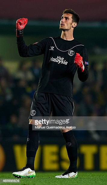 Sergio Rico of Villarreal reacts during the UEFA Europa League round of 16 match between Villarreal and FC Sevilla at Estadio El Madrigal on March 12...