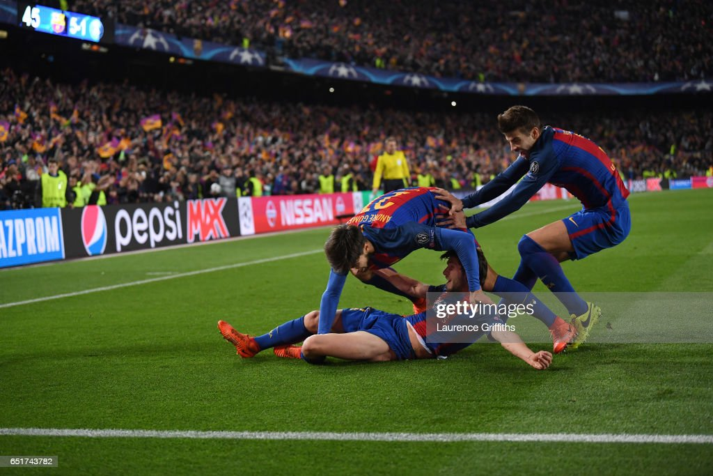 Sergio Roberto of Barcelona is congratulated on scoring the sixth goal during the UEFA Champions League Round of 16 second leg match between FC Barcelona and Paris Saint-Germain at Camp Nou on March 8, 2017 in Barcelona, Spain.