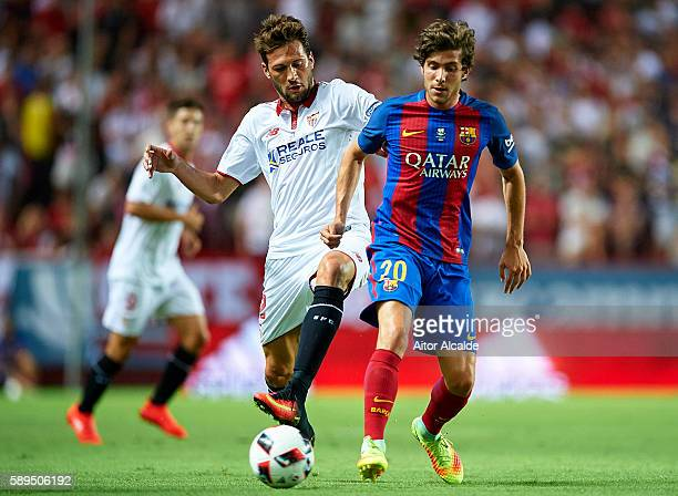 Sergio Roberto of FC Barcelona being followed by Franco Vazquez of Sevilla FC during the match between Sevilla FC vs FC Barcelona as part of the...