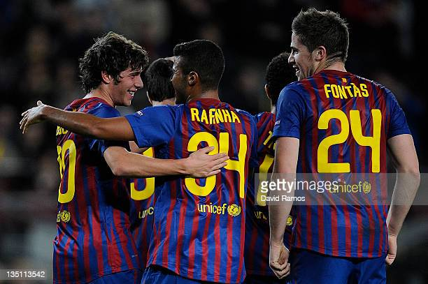 Sergio Roberto of FC Barcelona celebrates with his teammate Rafinha and Andreu Fontas of FC Barcelona after scoring the opening goal during the UEFA...