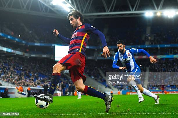 Sergio Roberto of FC Barcelona competes for the ball with Alvaro Gonzalez of RCD Espanyol during the Copa del Rey Round of 16 second leg match...