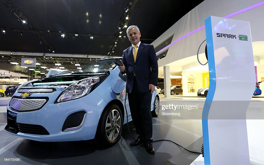 Sergio Rocha, chief executive officer of GM Korea Co., poses for a photograph next to the company's Spark electric vehicle during the press day of the Seoul Motor Show in Goyang, South Korea, on Thursday, March 28, 2013. General Motors Co.'s South Korean unit said a strengthening won is undermining competitiveness in a way that threatens the business's sustainability. Photographer: SeongJoon Cho/Bloomberg via Getty Images