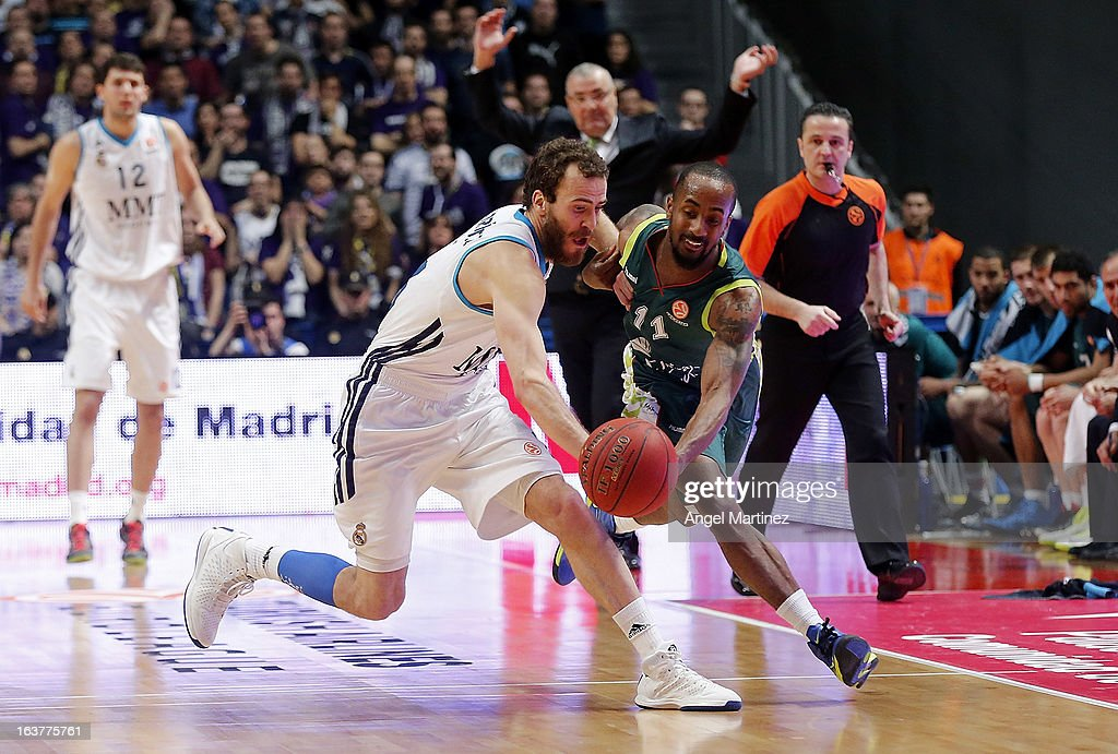 <a gi-track='captionPersonalityLinkClicked' href=/galleries/search?phrase=Sergio+Rodriguez&family=editorial&specificpeople=765161 ng-click='$event.stopPropagation()'>Sergio Rodriguez</a> #13 of Real Madrid competes for the ball with Earl Calloway #11 of Unicaja Malaga during the Turkish Airlines Euroleague Top 16 game at Palacio de los Deportes on March 15, 2013 in Madrid, Spain.