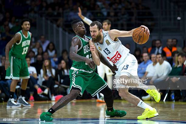 Sergio Rodriguez of Real Madrid drives against Terry Roizer of Boston Celtics during the friendlies of the NBA Global Games 2015 basketball match...