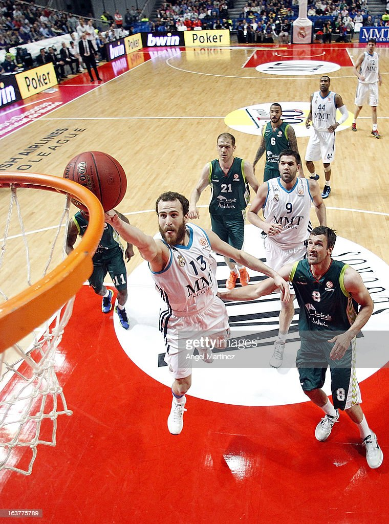 <a gi-track='captionPersonalityLinkClicked' href=/galleries/search?phrase=Sergio+Rodriguez&family=editorial&specificpeople=765161 ng-click='$event.stopPropagation()'>Sergio Rodriguez</a> #12 of Real Madrid goes to the basket against Andy Panko #8 of Unicaja Malaga during the Turkish Airlines Euroleague Top 16 game at Palacio de los Deportes on March 15, 2013 in Madrid, Spain.