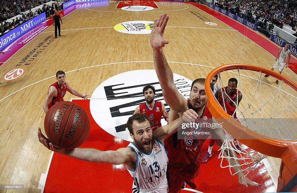Sergio Rodriguez #13 of Real Madrid goes to the basket against Nenad Krstic #12of CSKA Moscow during the Turkish Airlines Euroleague Top 16 game at Palacio de los Deportes on January 31, 2013 in Madrid, Spain.