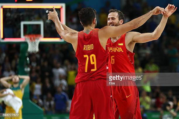 Sergio Rodriguez of Spain and Ricky Rubio of Spain celebrate winning the Men's Basketball Bronze medal game between Australia and Spain on Day 16 of...