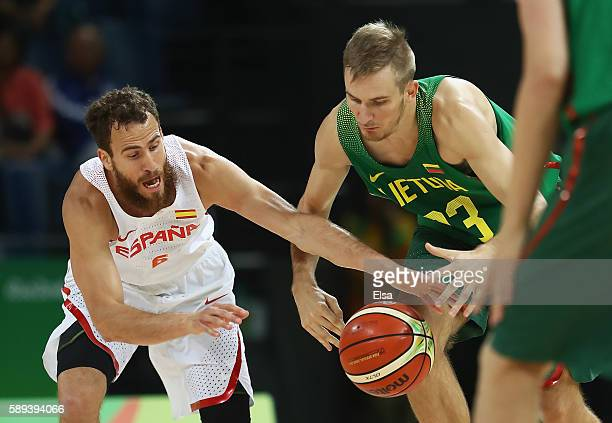 Sergio Rodriguez of Spain and Vaidas Kariniauskas of Lithuania go for the loose ball during the Men's Preliminary Round Group B between Spain and...