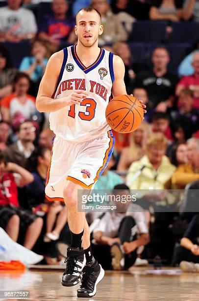 Sergio Rodriguez of the New York Knicks dribbles the ball against the Phoenix Suns during the game at US Airways Center on March 26 2010 in Phoenix...