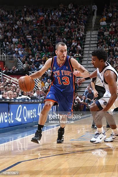 Sergio Rodriguez of the New York Knicks drives to the basket against Ronnie Price of the Utah Jazz during the game at the EnergySolutions Arena on...