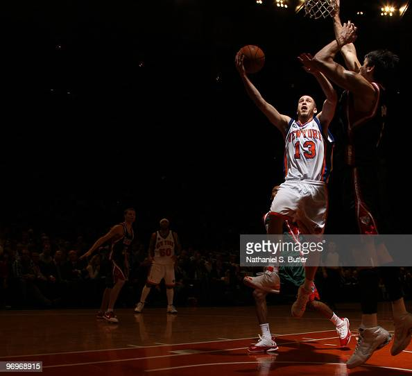 Sergio Rodriguez of the New York Knicks shoots against Andrew Bogut of the Milwaukee Bucks on February 22 2010 at Madison Square Garden in New York...