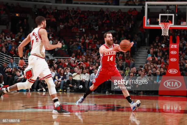 Sergio Rodriguez of the Philadelphia 76ers passes the ball against the Chicago Bulls on March 24 2017 at the United Center in Chicago Illinois NOTE...