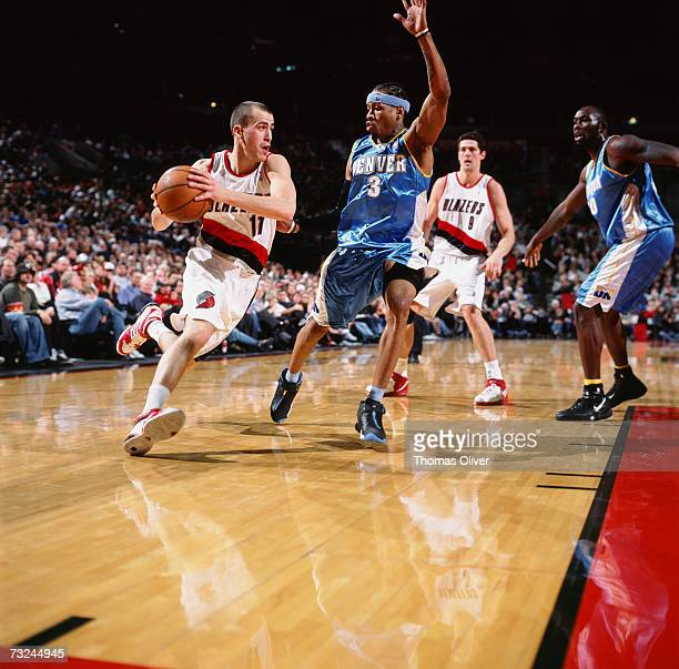 Sergio Rodriguez of the Portland Trail Blazers drives to the basket against Allen Iverson of the Denver Nuggets during a game at The Rose Garden on...