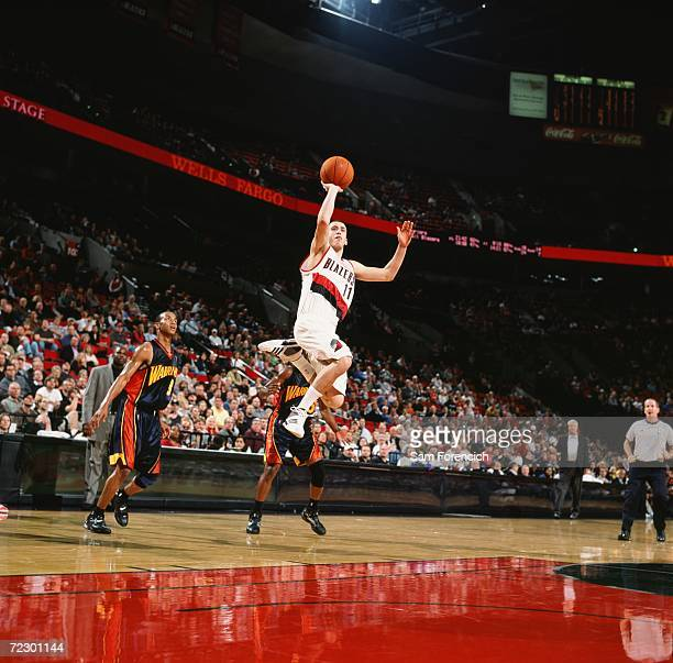 Sergio Rodriguez of the Portland Trail goes up for a shot during a preseason game against the Golden State Warriors at The Rose Garden on October 17...
