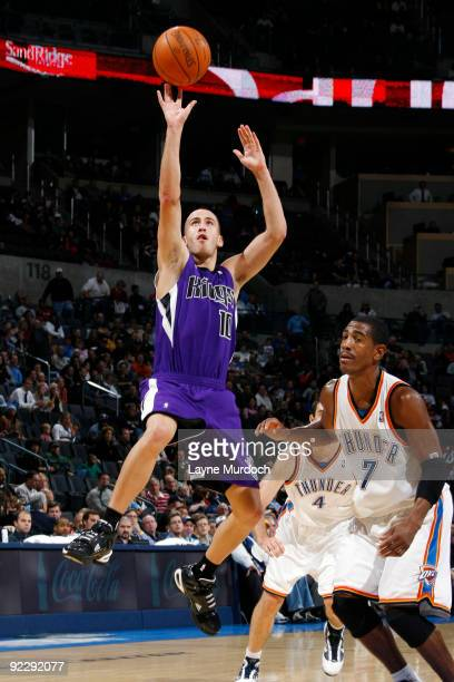 Sergio Rodriguez of the Sacremento Kings shoots a jump shot against Kevin Ollie of the Oklahoma City Thunder on October 22 2009 at the Ford Center in...