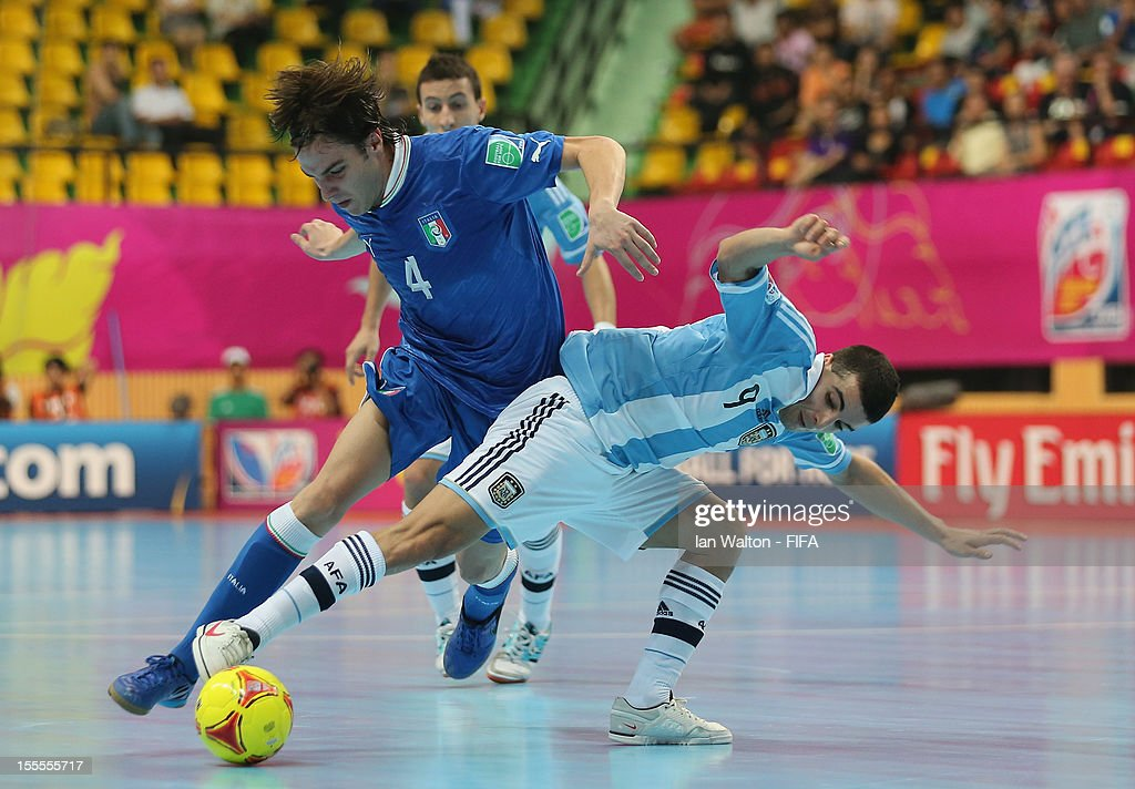 Sergio Romano of Italy is tackled by Cristian Borruto of Argentina during the FIFA Futsal World Cup Thailand 2012, Group D match between Argentina and Italy at Nimibutr Stadium on November 5, 2012 in Bangkok, Thailand.