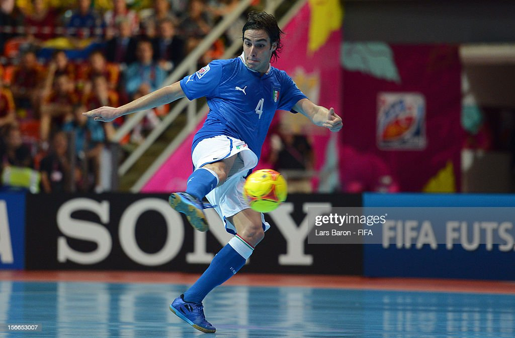 Sergio Romano of Italy scores his teams first goal during the FIFA Futsal World Cup 3rd/4th Playoff match at Indoor Stadium Huamark on November 18...