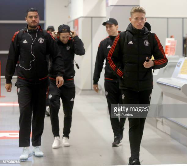 Sergio Romero and Scott McTominay of Manchester United check in ahead of their flight to Basel at Manchester Airport on November 21 2017 in...
