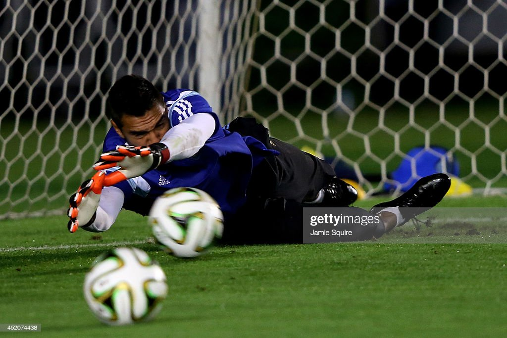 Sergio Romero makes a save during the Argentina training session, ahead of the 2014 FIFA World Cup Final, at Estadio Sao Januario on July 12, 2014 in Rio de Janeiro, Brazil.