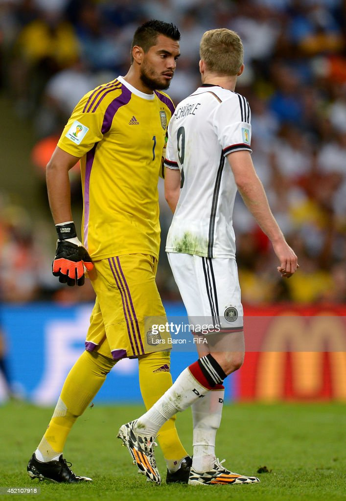 Sergio Romero of Argentina and Andre Schuerrle of Germany argue during the 2014 FIFA World Cup Brazil Final match between Germany and Argentina at Maracana on July 13, 2014 in Rio de Janeiro, Brazil.