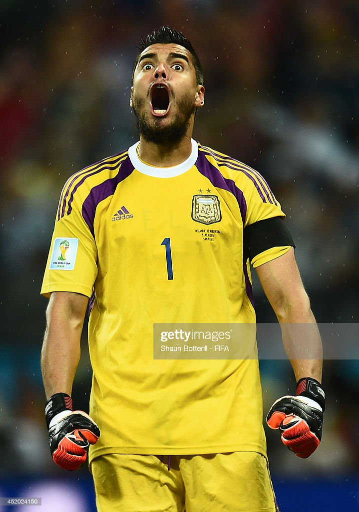 Sergio Romero of Argentina celebrates after saving the penalty kick by Wesley Sneijder of the Netherlands in the penalty shootout during the 2014 FIFA World Cup Brazil Semi Final match between Netherlands and Argentina at Arena de Sao Paulo on July 9, 2014 in Sao Paulo, Brazil.